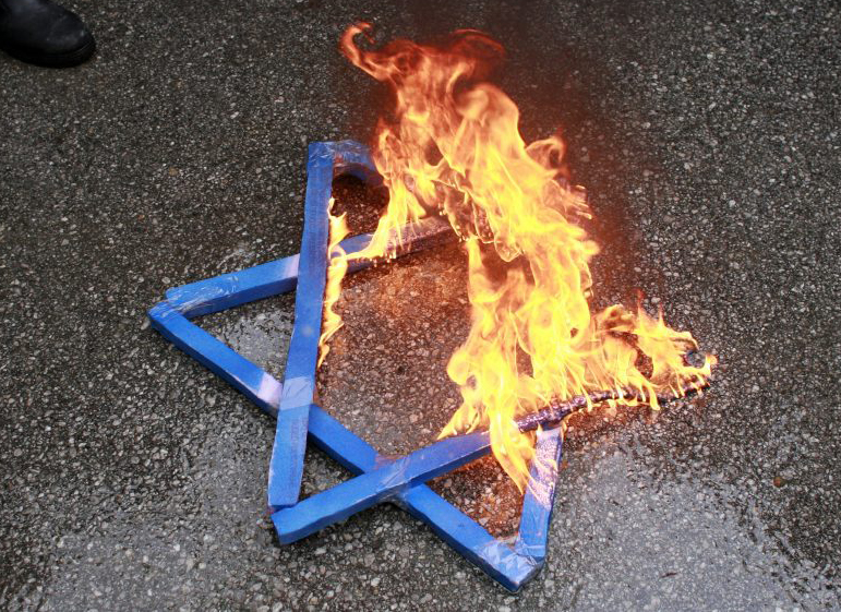 Photo of a burning Jewish Star