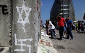 Star of David and Swastika painted onto wall in Mid East Lebanon