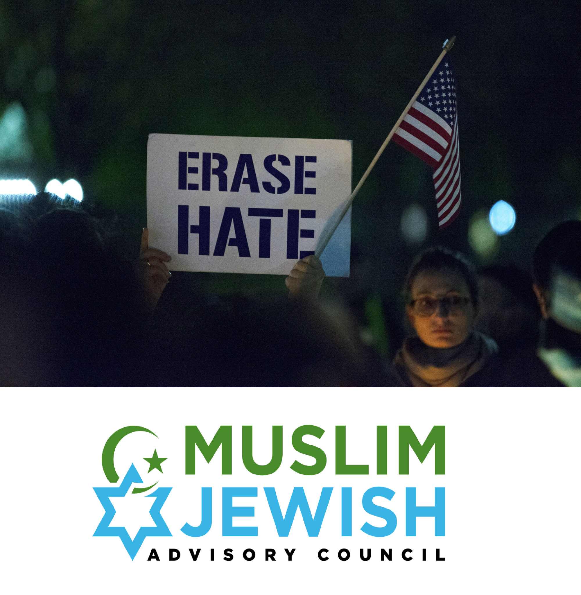 "A person holding up a sign that says ""Erase Hate"" at a rally with the MJAC Logo underneath"