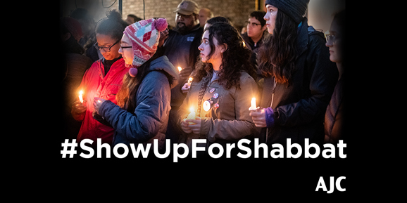Vigil in Pittsburgh, with hashtag #ShowUpForShabbat and the AJC logo.